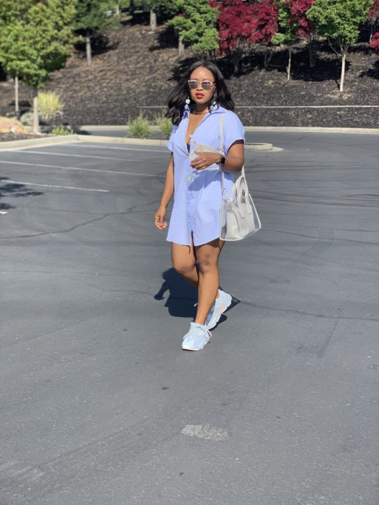 Blogger Steffanie Monae is wearing a white double breasted oversized zara blazer. It is paired with a Zara shirt dress and Adidas Yeezy Boost 700.